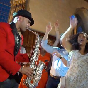Saxophonist and Crowd dancing at a party